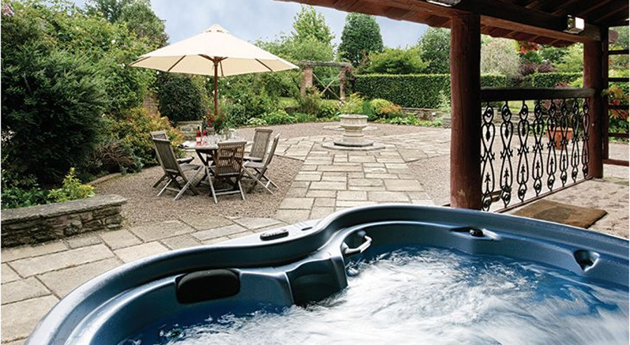 Relax in the hot tub at Bearwood House