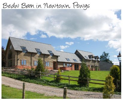 Bedw Barn is a large holiday cottage in Newtown, Powys. Bedw Barn sleeps 14 people and has a hot tub