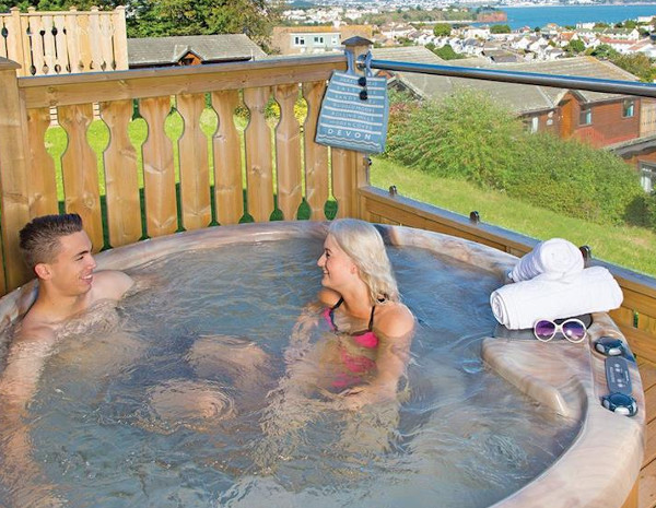 A lodge with a hot tub at Beverley View in Devon
