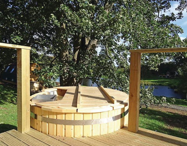 Some of the pods at Blossom Plantation Pods have their own wood fired hot tub
