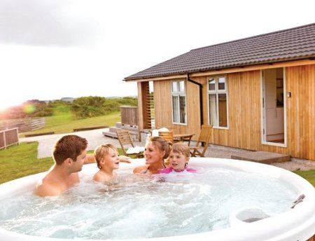 A hot tub at one of the lodges at Caddys Corner Lodges