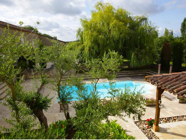 The swimming pool and garden at Chateau Tournesol in Agen, Aquitaine