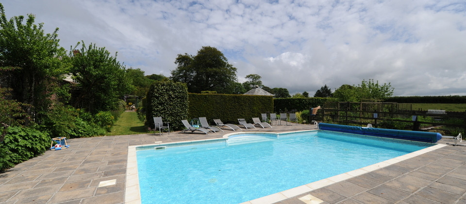 Make the most of the swimming pool at Glebe House Cottages