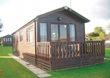 One of the lodges at Saundersfoot Pine Lodges in Moreton