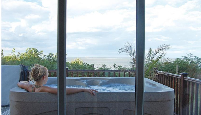 Watch the sun coming up, while in your hot tub at Ocean Lodges in Suffolk