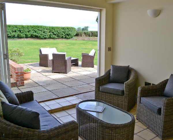 The living room at Three Horseshoes House, with views to the garden