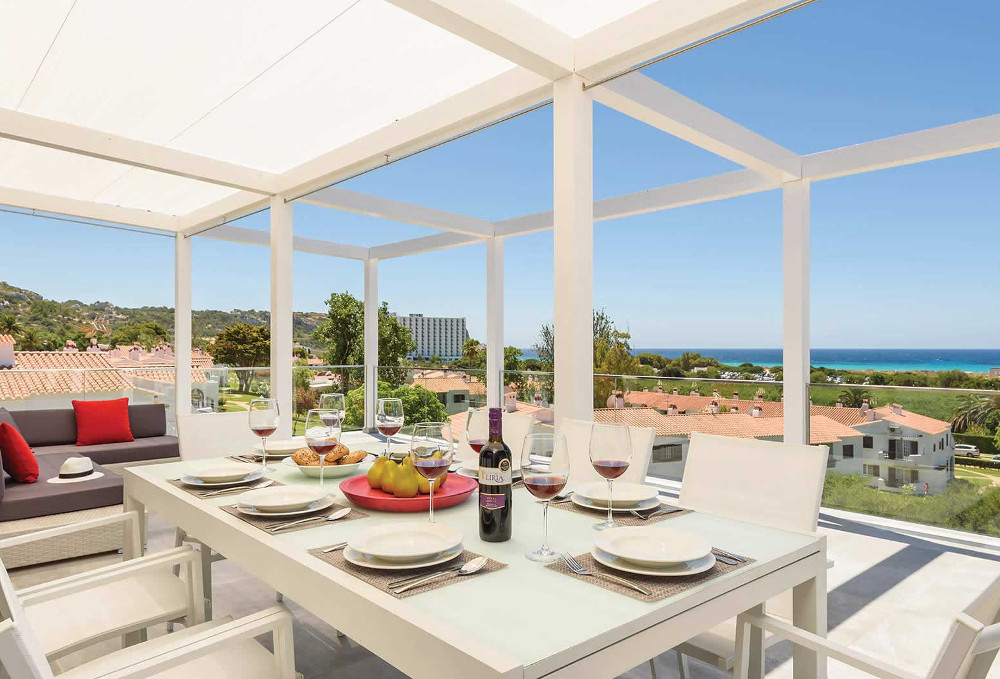 Shaded dining, and views over to the sea at Villa Dolce Vita on Menorca