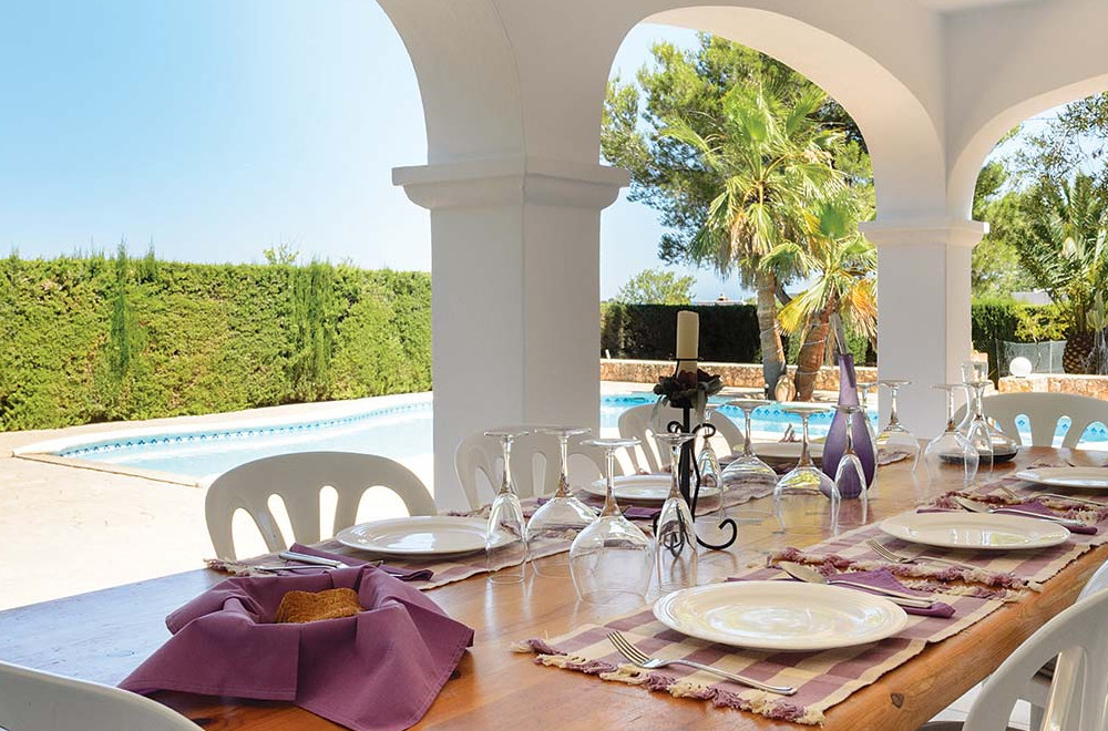 Al fresco dining with views over the garden and swimming pool at Villa Oasis