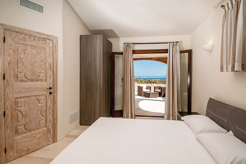 One of the five bedrooms at Villa Pevero Hill 1 in Porto Cervo, Sardinia